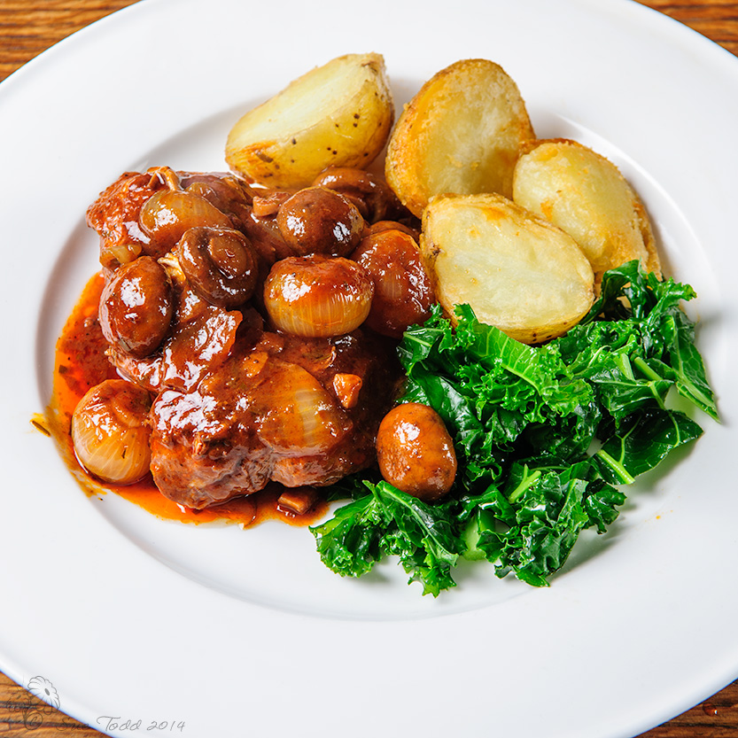 Chicken chasseur with roast potatoes and kale. © Sue Todd 2014