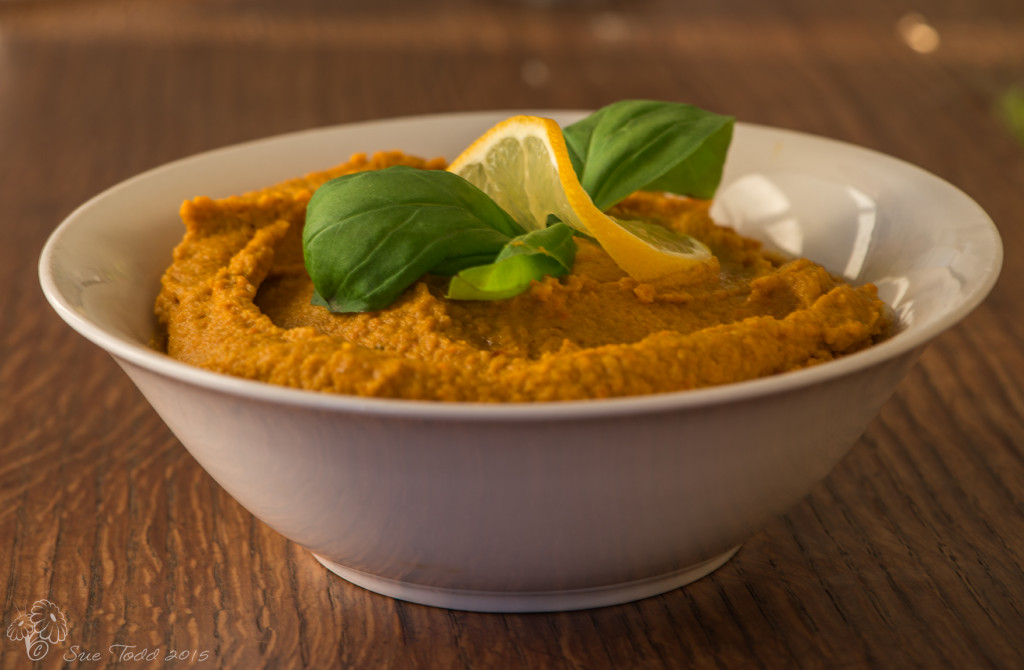 Carrot Hummus garnished with basil and lemon © Sue Todd 2015.